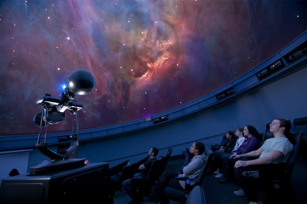 a wide angle shot of space in the planetarium