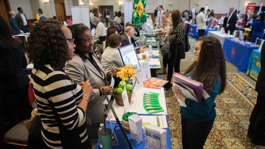 Student speaks with potential employers at a career fair