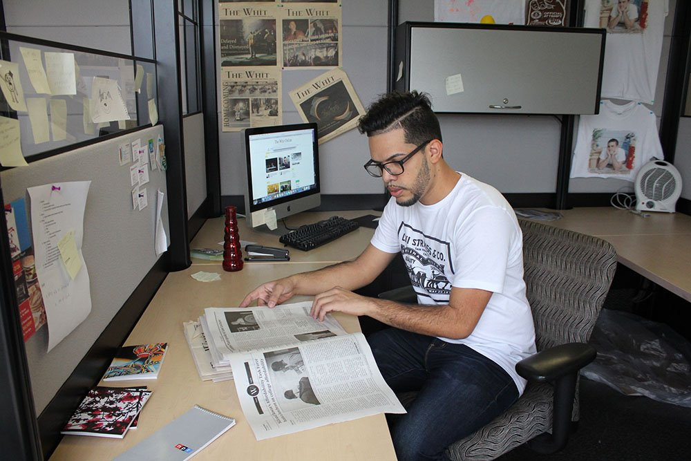 Student reading The Whit newspaper