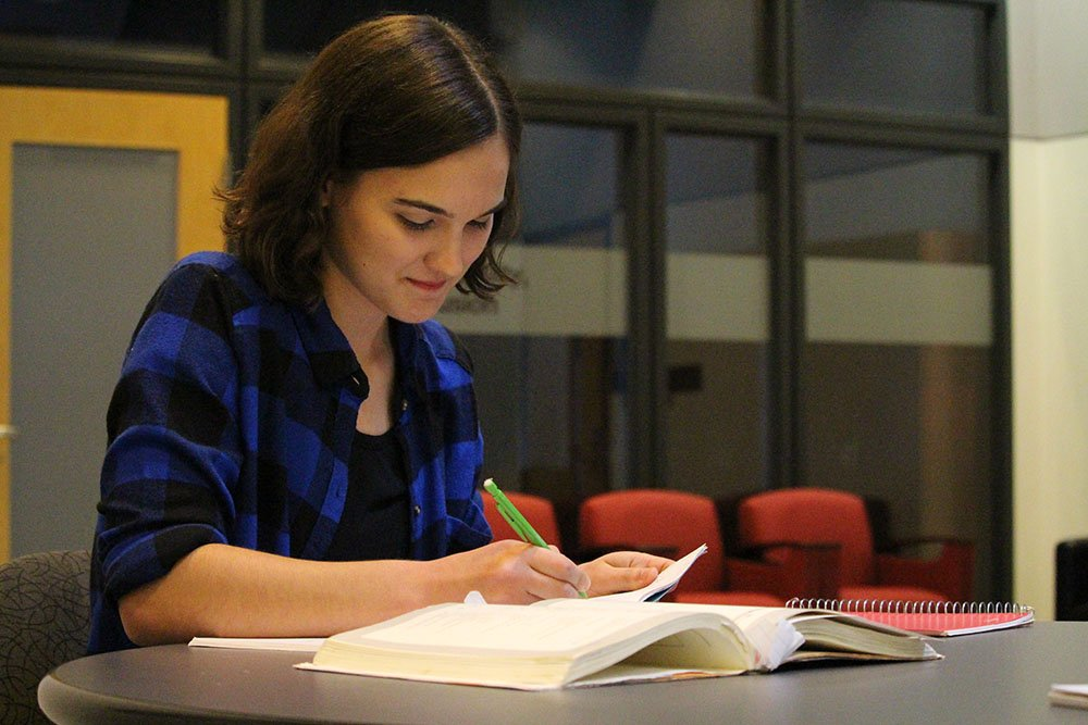 Rachel V., a Modern Language & Linguistics major, photographed studying