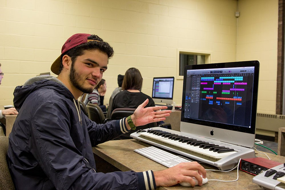Music Industry major Ricardo O. working on a school project