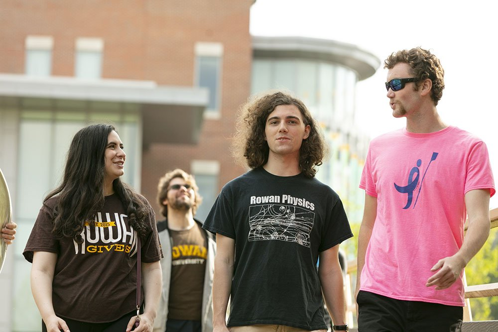 Students in t-shirts walking outside