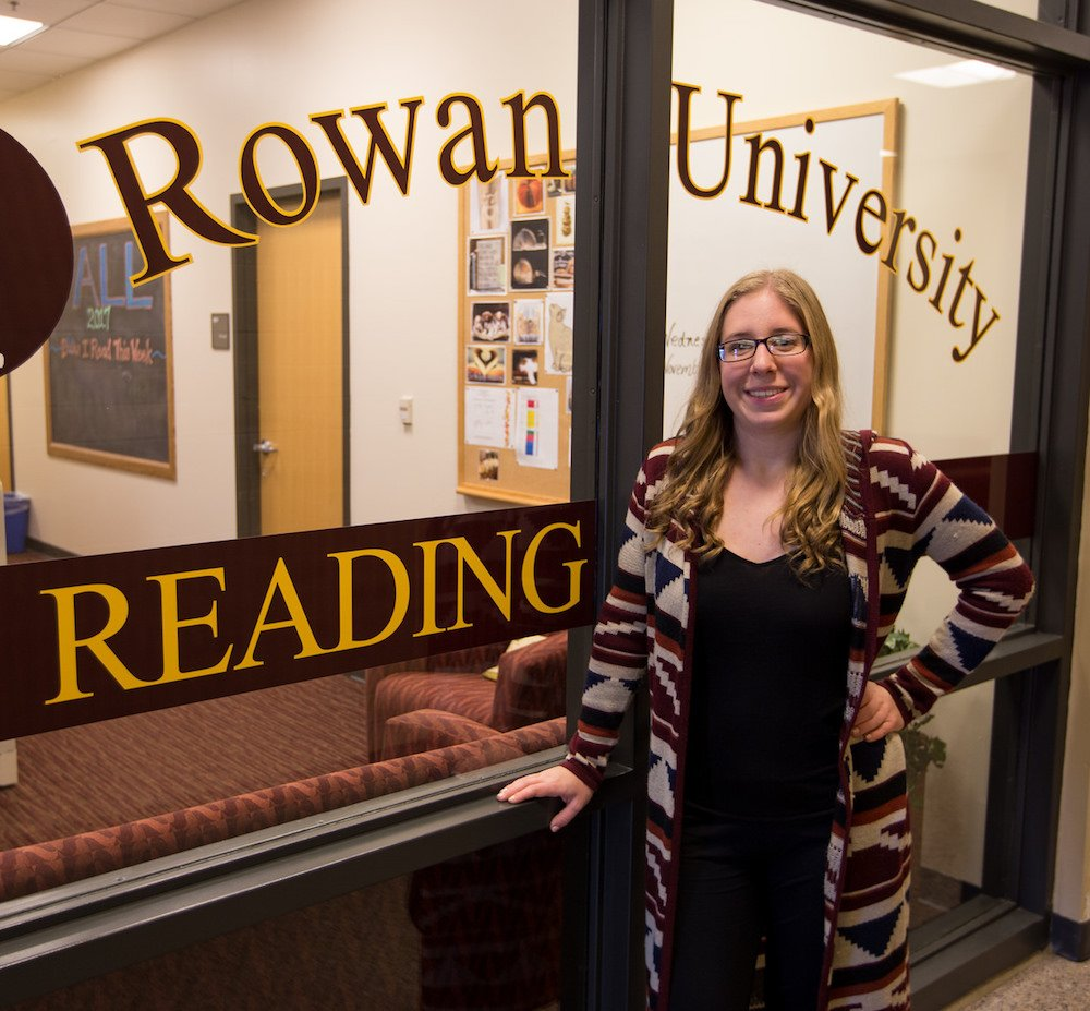 Melissa standing in front of the Rowan University reading clinic