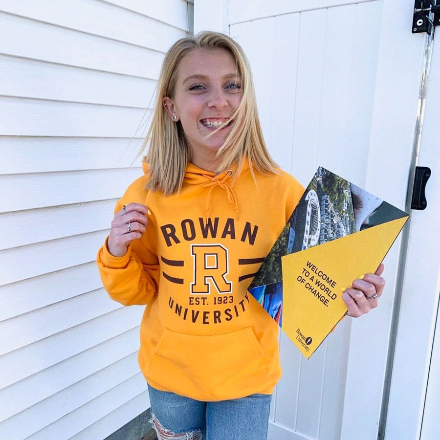 girl holding acceptance package